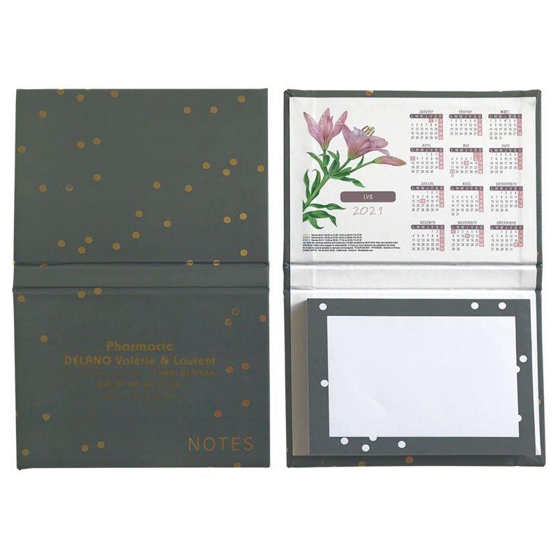 Bloc notes calendrier gris visuel fleurs macro